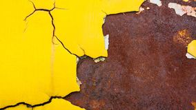 Yellow crack texture at rusty metal plate. Yellow crack texture for background Royalty Free Stock Images