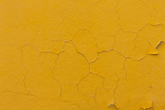 Yellow cracked wall background. Yellow cracked wall abstract background royalty free stock images