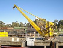 Yellow Crane. An old yellow dock crane at Murray Bridge in South Australia Royalty Free Stock Image