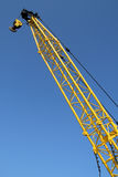 A yellow crane. Stock Image