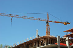 Yellow Crane. On construction project Royalty Free Stock Photos