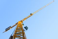 Yellow crane. On a sunny day, with blue cloudless sky in the background royalty free stock photo
