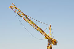 Yellow crane against blue sky Royalty Free Stock Photography
