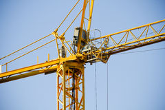 Yellow Crane against Blue Sky Stock Photos