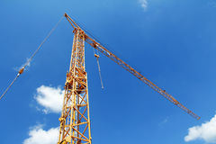 Yellow crane against the blue sky Stock Photo