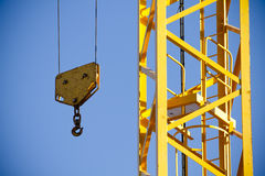 Yellow Crane against Blue Sky , tower with hook Stock Photo