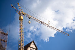 Yellow crane with blue sky Royalty Free Stock Photos