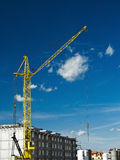 Yellow crane and buildings Stock Photo
