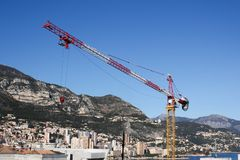 Yellow Crane with city in the background Royalty Free Stock Images