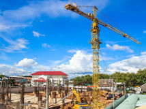 Yellow crane in a construction site Royalty Free Stock Image