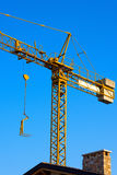 Yellow Crane in Construction Work Site Stock Images