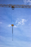 Yellow Crane hook on steel cables with chains 2 Royalty Free Stock Photo