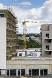 Yellow crane of house apartment construction site Stock Images