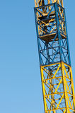 Yellow crane ladder with blue sky background Royalty Free Stock Photo