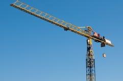 Yellow crane lifting materials Stock Photos