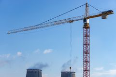 Crane at the construction site stock images