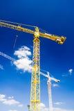 Yellow crane over blue sky stock photo