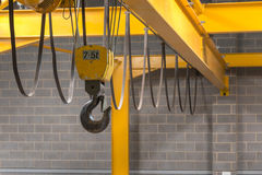Yellow Crane's Hook. Yellow Indoor Crane's Hook and Black Sling Royalty Free Stock Photo
