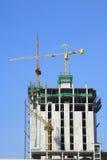 Yellow crane at top level skyscraper Stock Image
