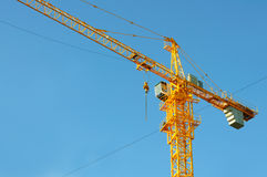 Yellow crane tower. On blue sky background Royalty Free Stock Image