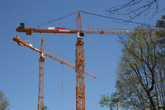 Yellow Cranes. Two yellow cranes above construction project Stock Photography