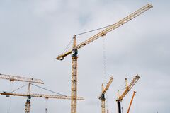 Free Yellow Cranes Against The Blue Sky. Construction Background. Royalty Free Stock Images - 217016599