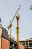 Yellow Cranes Over New Construction Stock Image