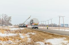 Transportation of oversized cargo on a truck under electric transmission wires stock photos