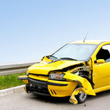 Yellow crash. Front view of crashed yellow car at highway royalty free stock photos