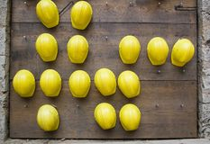 Yellow crash-helmets. On the wall royalty free stock photography