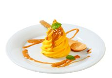 Yellow cream with caramel sauce Royalty Free Stock Images