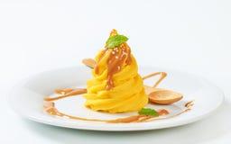 Yellow cream with caramel sauce Stock Photo