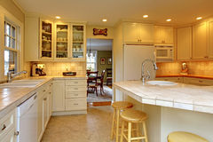 Yellow cream white luxury kitchen Stock Photo