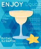 Yellow creamy cocktail in margarita glass with star fruit on blu Royalty Free Stock Images