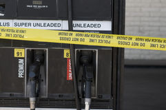 Yellow crime scene tape surrounds gas station Royalty Free Stock Image