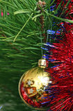 Yellow Cristmas ball on the Cristmas tree Stock Photos