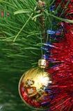 Yellow Cristmas ball on the Cristmas tree Stock Photos