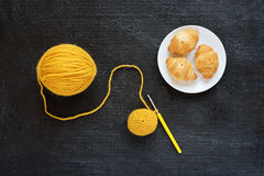 Yellow crocheting and croissants Stock Photo