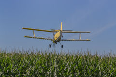 Yellow Crop Duster. A crop duster applies chemicals to a field of vegetation Stock Images