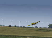 Yellow Crop Duster. A crop duster applies chemicals to a field of vegetation Royalty Free Stock Photos