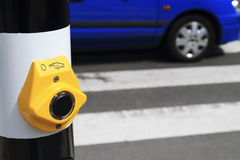 Yellow crosswalk button Stock Images