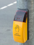 Yellow crosswalk button on the pedestrian crossing Stock Image