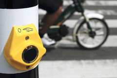 Yellow crosswalk button with scooter Royalty Free Stock Photography