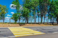Yellow crosswalk empty highway Stock Photos
