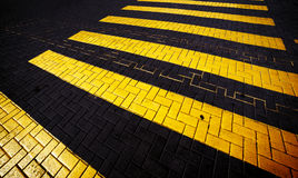 Yellow crosswalk on the road, abstract background. Stock Photo