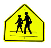 Yellow crosswalk sign. Showing two pedestrians.  Isolated against a white background Royalty Free Stock Photos