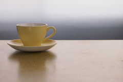 Yellow Crown Lynn Cup. And Saucer on a Formica Table Royalty Free Stock Images