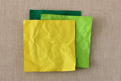 Yellow crumbled post it Stock Photo