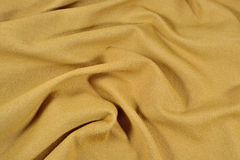 Yellow crumpled denim background Royalty Free Stock Photos