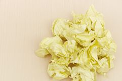 Yellow crumpled paper Stock Images